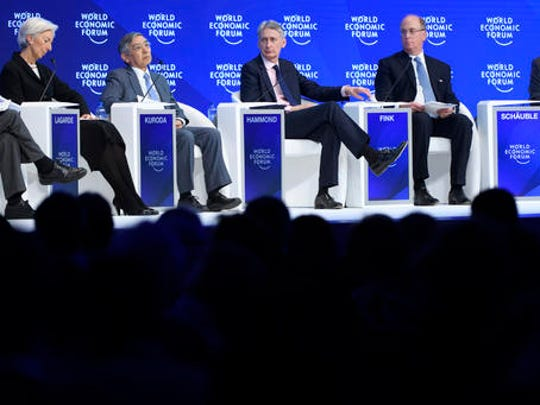 From left, France's Christine Lagarde, Managing Director of the International Monetary Fund, IMF, Bank of Japan Governor Haruhiko Kuroda, British Treasury Chief Philip Hammond, Laurence D. Fink, Chairman and CEO of BlackRock Inc. and German Finance Minister Wolfgang Schaeuble attend a plenary session during the closing day of the 47th annual meeting of the World Economic Forum, WEF, in Davos, Switzerland, Friday, Jan. 20, 2017.