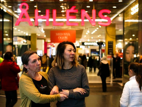 People exit and enter the reopened department store Ahlens in Stockholm, Sweden, Monday, April 10, 2017. Swedes questioned their country's welcoming immigration policies with pride and pain after learning that an asylum-seeker from Uzbekistan was allegedly behind the truck rampage that killed four people, Stockholm's deadliest extremist attack in years.