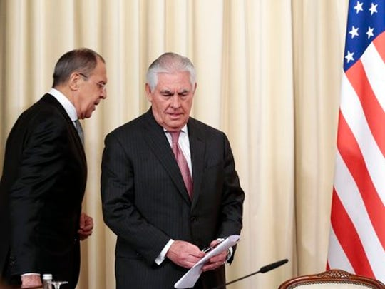 Russian Foreign Minister Sergey Lavrov, left, and US Secretary of State Rex Tillerson arrive to attend a news conference following their talks in Moscow, Russia, Wednesday, April 12, 2017. Amid a fierce dispute over Syria, the United States and Russia agreed Wednesday to work together on an international investigation of a Syrian chemical weapons attack last week.