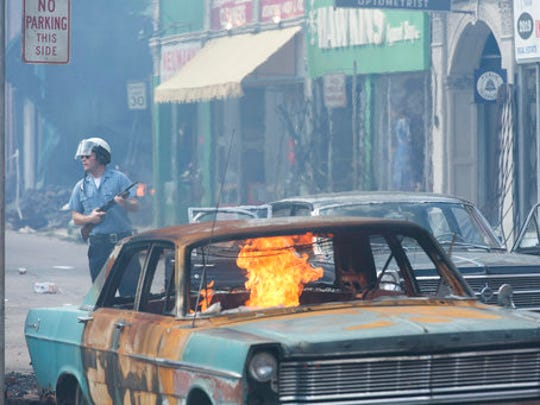 "This image released by Annapurna Pictures shows a scene from the 1967 riots drama ""Detroit."" Directed by Kathryn Bigelow, the film opens Aug. 4."