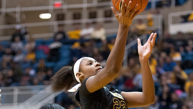 West Virginia's Bria Holmes drives by Kansas' Bunny Williams during the second half in Morgantown, W.Va.