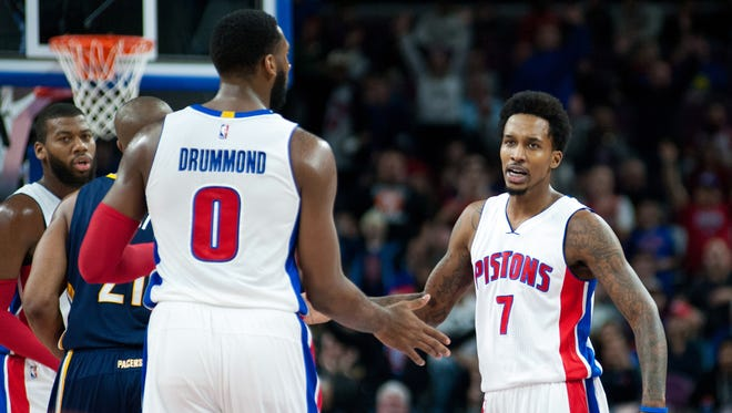 Detroit Pistons guard Brandon Jennings (7) high fives Detroit Pistons center Andre Drummond (0) during the first quarter against the Indiana Pacers at The Palace of Auburn Hills.
