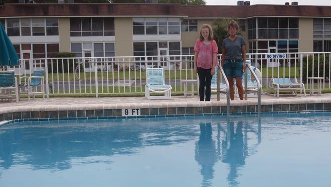 Maya DiGiacomo and Kathy McElmurray chat near the swimming pool.