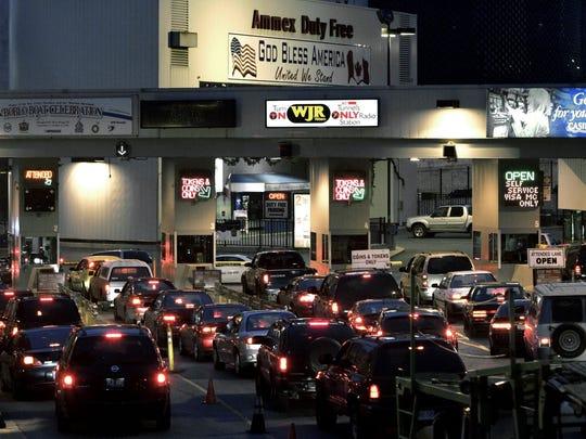 Motorists line up at the Detroit-Windsor Tunnel in Detroit on Thursday, Nov. 10, 2005.