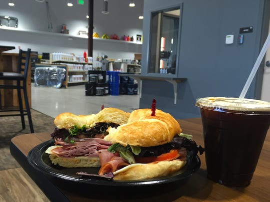 Ham sandwich on a croissant with romaine lettuce, tomato, cheese and spicy ranch ($3.89) with a small nitro coffee ($4).