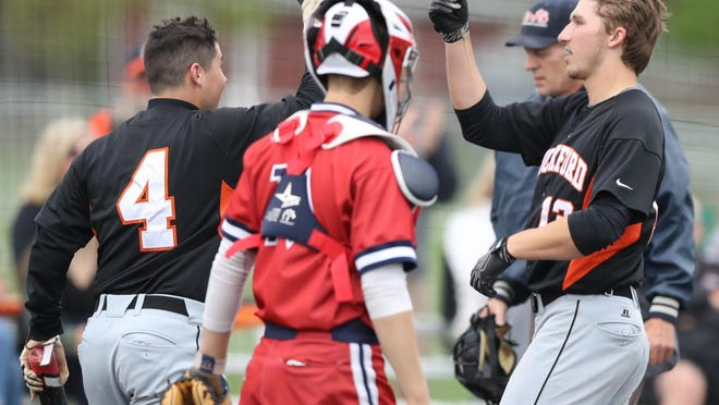 Rockford's Jack Weisenburger, right, is met by Khale Showers after his two-run homer against Grosse Pointe Woods University Liggett on Saturday.