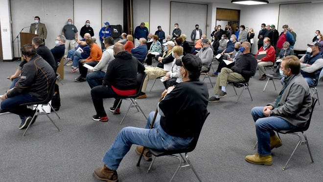 Several Monroe Charter Township residents are pictured at a meeting earlier this month in which the municipality's Planning Commission addressed applications to establish marijuana businesses. The township recently unveiled a committee comprised of citizens who will offer their perspective on its marijuana ordinance.