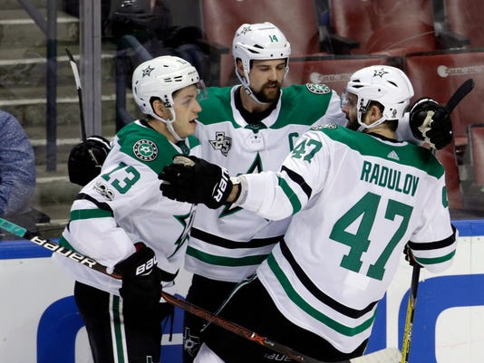Dallas Stars' Jamie Benn, center, celebrates with Mattias Janmark (13), of Sweden, and Alexander Radulov (47), of Russia, during the first period of an NHL hockey game against the Florida Panthers, Tuesday, Nov. 14, 2017, in Sunrise, Fla. (AP Photo/Lynne Sladky)