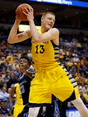 Marquette's Henry Ellenson during the first half of an NCAA college basketball game against Maine Saturday, Dec. 5, 2015, in Milwaukee.