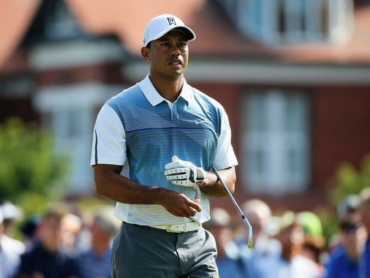 tiger woods starts slow but rolls to an opening 69 at