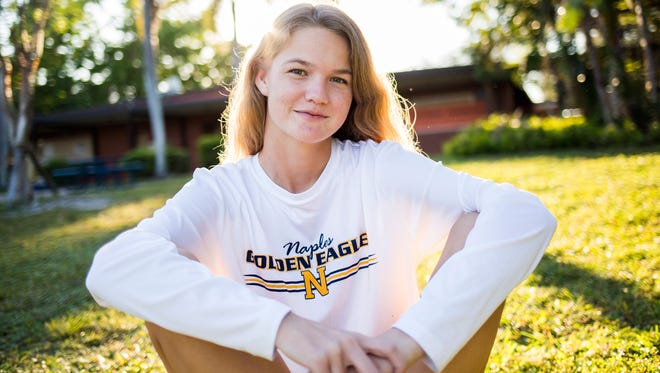 Caitlin Crowley, a senior at Naples High School, sits down for a portrait in the green space of her school's campus on Thursday, Nov. 2, 2017.