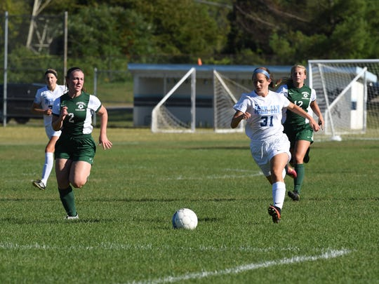 Cornwall's Madison Teague, left, chases after John Jay's Kiley Longin, right, for possession of the ball during Monday's game.