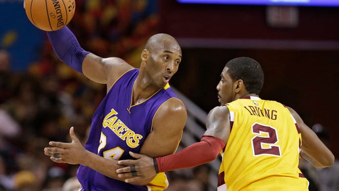 Los Angeles Lakers' Kobe Bryant (24) drives against Cleveland Cavaliers' Kyrie Irving (2) in the second half of an NBA basketball game Wednesday, Feb. 10, 2016, in Cleveland. The Cavaliers won 120-111. (AP Photo/Tony Dejak)