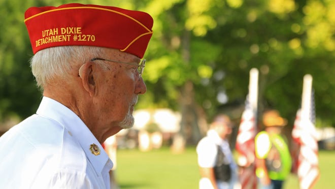 Gordon Farr, of Marine Corps League 1270, listens to a speaker during a 2016 Memorial Day service at Veterans Park in Washington City.