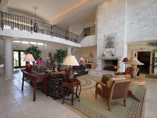 The foyer at 843 South Drive has a double staircase, and an arched bridge floats over the great room.