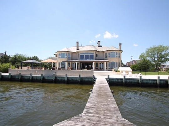 This Brick mansion has panoramic views of the water an an outdoor gazebo kitchen.