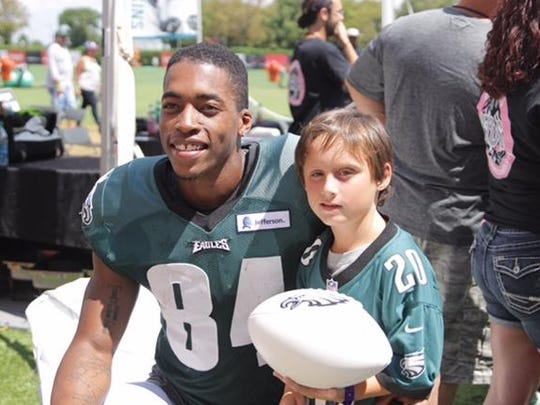 Former UD receiver Mike Johnson poses with Danny Feltwell at Philadelphia Eagles camp in 2015.