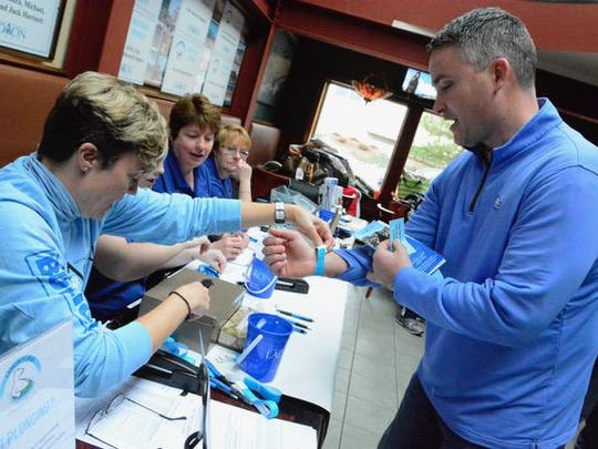 Left: Mike Hartnett (right) registers for the LADACIN Plunge on Saturday. Right: Scott Meade of Wall is shown at the event.