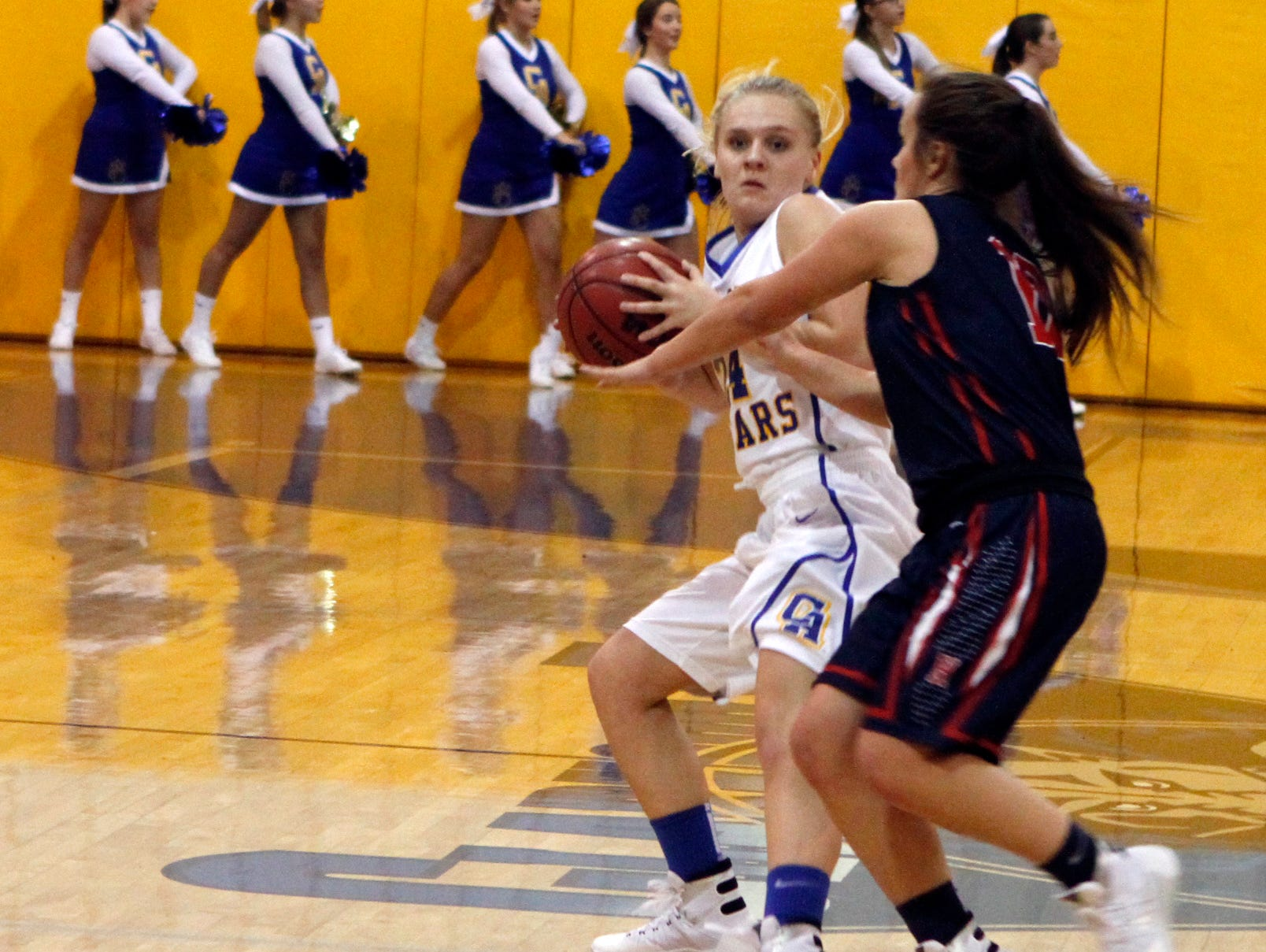Clarksville Academy's Abbey Hogan faced a strong White House-Heritage defense Thursday night. The Lady Cougars were held to just 20 points.