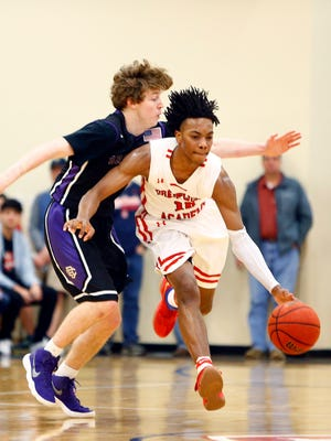 Brentwood Academy's Darius Garland (10) brings the ball up court as he's defended by a Christian Brothers defender during their Division II-AA state quarterfinal game Saturday. Brentwood Academy won 63-58.