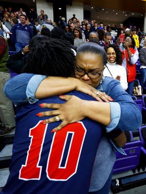 Brentwood Academy's Darius Garland gets a hug from his mother, Felicia, after defeating Baylor in the Division II-AA state championship game on Saturday.