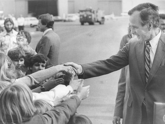 In 1982: First- and fifth-graders from Hunter Lake elementary reach out to shake hands with then-Vice President George Bush at Reno International Airport.