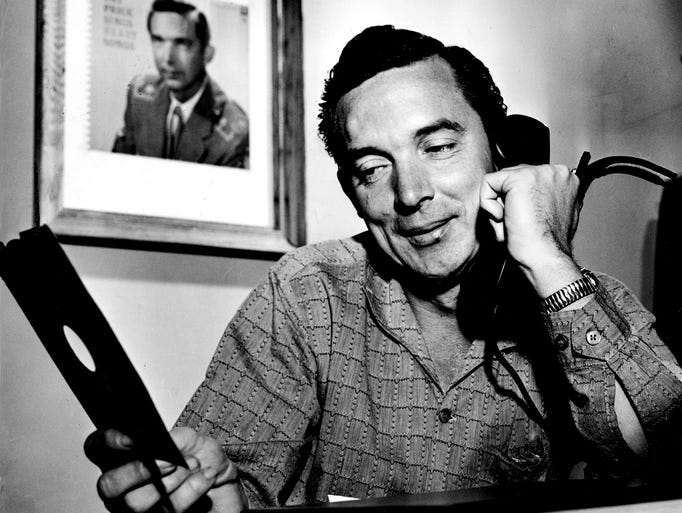 Ray Price ponders a record Dec. 12, 1959, as he talks to a friend. He had three records in the Top 20 that week.