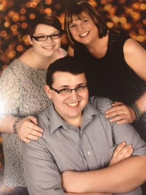 Lisa Cooper and her children, Brianna, 21, and Nathan, 20
