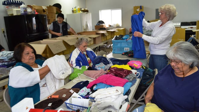 Volunteers sort items in the Compassionate Ministries Clothing Room in Clyde.