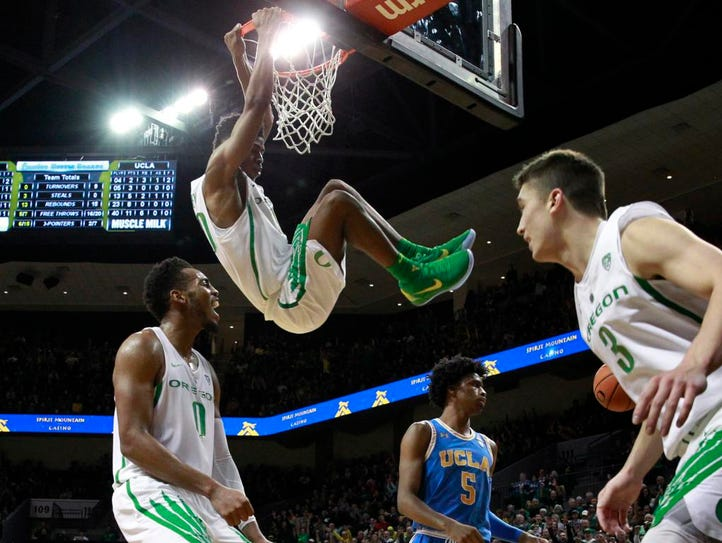 Oregon's Victor Bailey Jr. hangs from the rim after