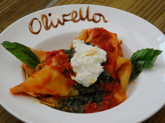 Fazzoletti di Olivella is made with handkerchief pasta, basil almond pesto, fresh ricotta and San Marzano tomato ragu.