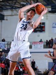 East Lansing's Brandon Johns grabs a rebound against