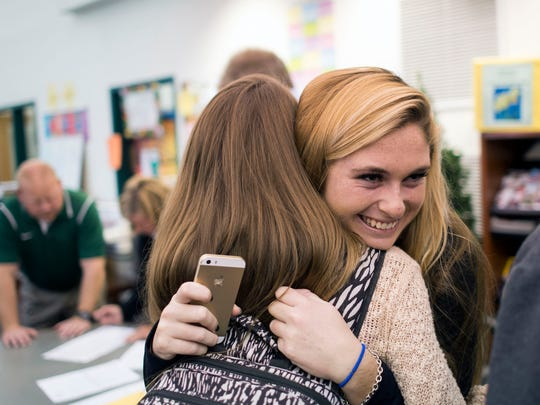 Indian River High School senior Maggie Allison, 17, right, is congratulated by teammate Lexi Haden, 16, after signing a letter of intent to play lacrosse for Towson University Thursday morning in Dagsboro.