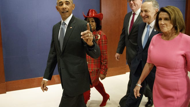 President Barack Obama, joined by, from second from left, Rep. Frederica Wilson (D-Fla.), Rep. Joseph Crowley (D-N.Y.), Senate Minority Leader Charles Schumer of N.Y., and House Minority Leader Nancy Pelosi of California, arrives on Capitol Hill on Wednesday to meet with members of Congress to discuss the Affordable Care Act.