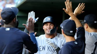New York Yankees second baseman Gleyber Torres (25) celebrates with teammates after hitting a two-run home run during the second inning.
