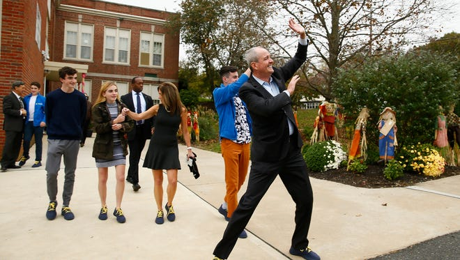 Phil Murphy waves to a group of women holding 'Women For Murphy' signs the Fairview Elementary School in Middletown after Murphy and his family cast their ballots on Election Day. November 7, 2017. Middletown, New Jersey