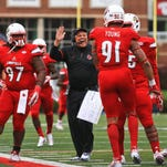 Louisville defensive coordinator Todd Grantham celebrates with his defensive line as the Cards squeezed the Orange 41-17 Saturday.