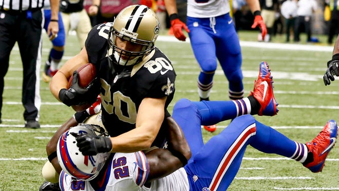 New Orleans Saints tight end Jimmy Graham (80) catches a touchdown past Buffalo Bills strong safety Da'Norris Searcy (25) during the first half of a game at Mercedes-Benz Superdome.