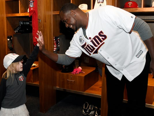 Minnesota Twins' Michael Pineda greets a young fan during the baseball team's TwinsFest on Friday, Jan. 19, 2018 in Minneapolis. (AP Photo/Hannah Foslien)