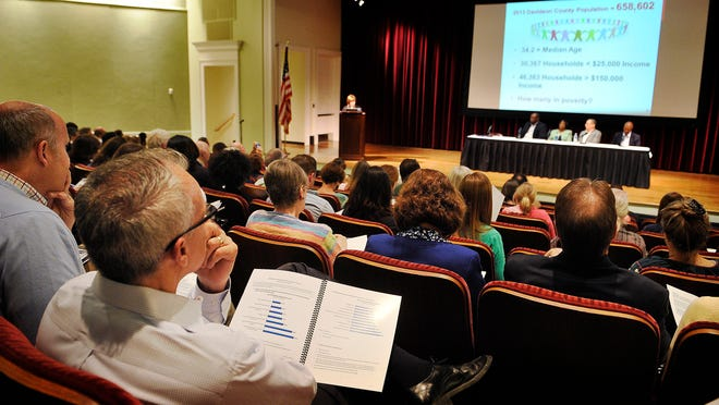 A packed auditorium listens as Metro Social Services presents its new poverty and community needs data during an event at the Nashville Public Library downtown.