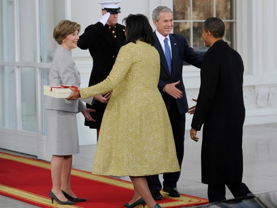 President Bush and first lady Laura Bush welcome the