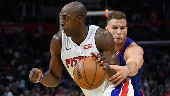 Clippers forward Blake Griffin, right, reaches in on Pistons forward Anthony Tolliver during the second half of the Pistons' 95-87 win on Saturday in Los Angeles.