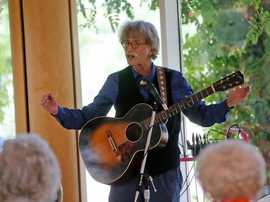 Hoyle Osborne speaks to the audience on June 13 during Jane Voss' and Osborne's performance at Farmington Museum at Gateway Park in Farmington.