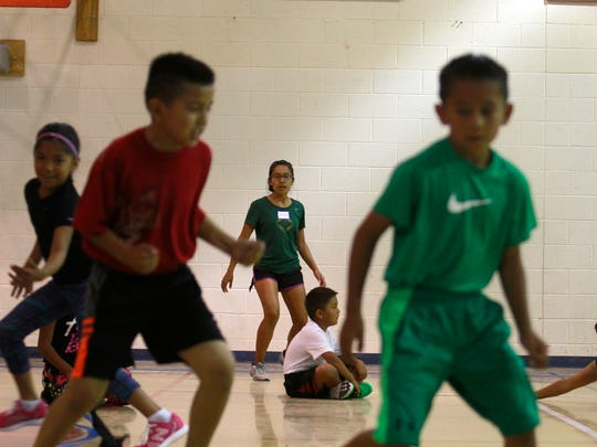 Participants in the Wings of America's Running and Fitness Camp play a game on Thursday at Ojo Amarillo Elementary School.