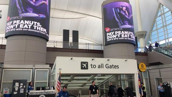 A TSA worker stands watch at Denver International Airport