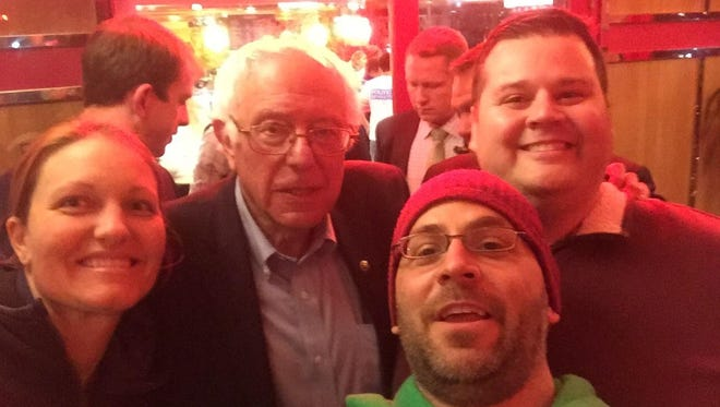 Sen. Bernie Sanders poses for a selfie at the Red Line Diner in Fishkill with, from left to right, Katy Behney, Leonard Behney, both of Beacon, and Gene Trifilo, of Glenham.