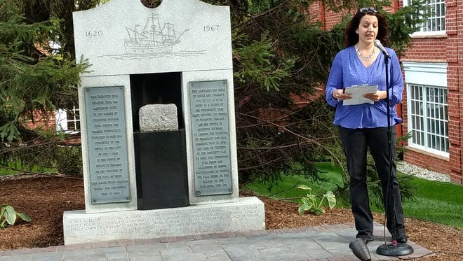 Christina Vega of the Rotary Club of Plymouth leads the dedication ceremony for the Plymouth Rock during Fall Festival.