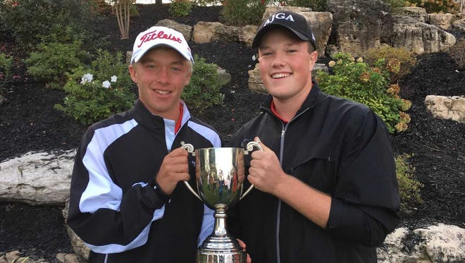 Castle golfers Adam Bratton (left) and Walker Beck (right) pose after helping Evansville win the 2017 Yestingsmeier Cup.