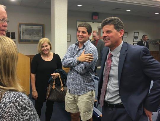 Garett Smith (right), of Newport News, talks with members