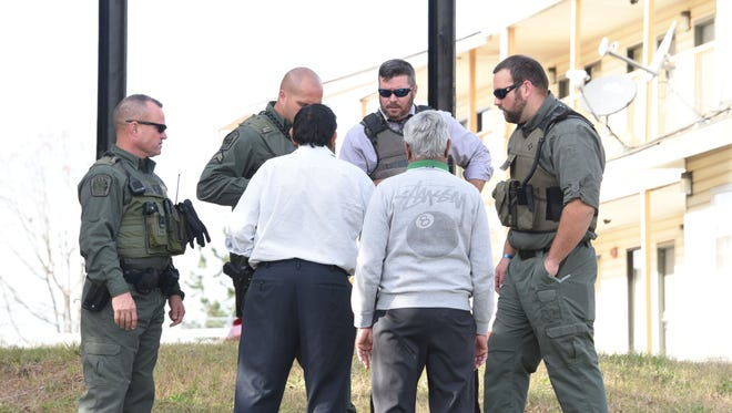 Law enforcement officers work at the scene of a stand-off at a Powdersville motel on Tuesday.
